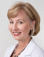 Dr. Gigi Meinecke, DMD, FAGD.