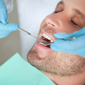 DontNeglectOfficeCleaningswithDentalImplants