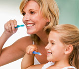 Mother and daughter brushing thier teeth