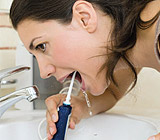 OralIrrigationforCleaningBetweentheTeeth