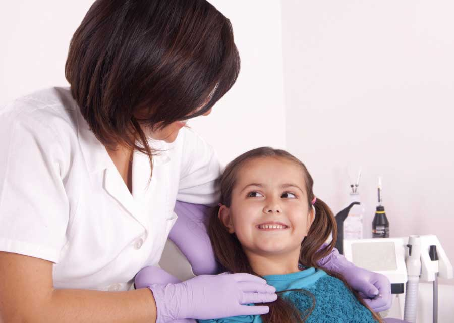 Dentist applying topical fluoride.