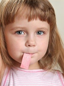 Kid chewing xylitol gum