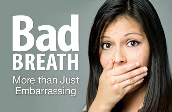 Woman covering mouth with bad breath.