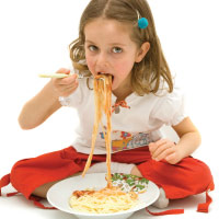 Child eating pasta.