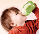 You should encourage the use of a training cup to replace a baby bottle!