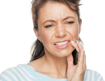 Woman experiencing tooth Pain.
