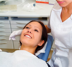 Image of a smiling patient in a dental chair
