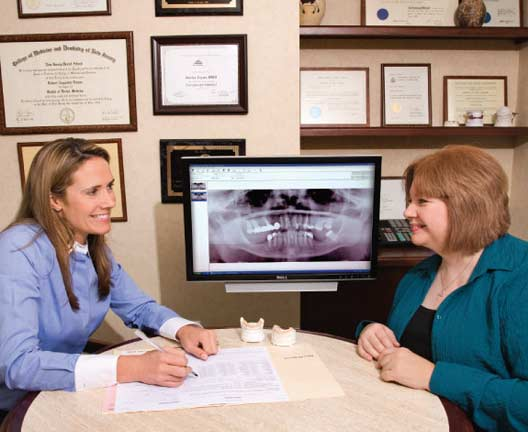 Dr. Jessica Logan talking to patient.