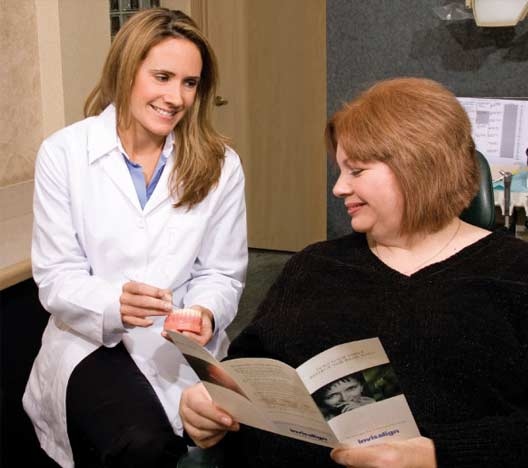 Dr. Jessica Logan talking to patient about invisalign.