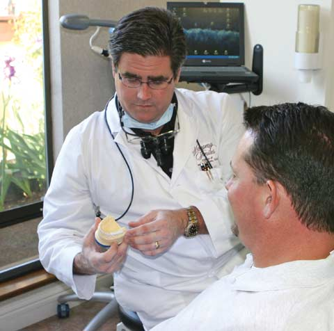 Dr. Wayne Sutton talking to patient.